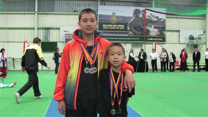 Jesse and Dylan with their medals