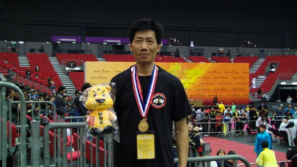 Samson Yip with gold medal